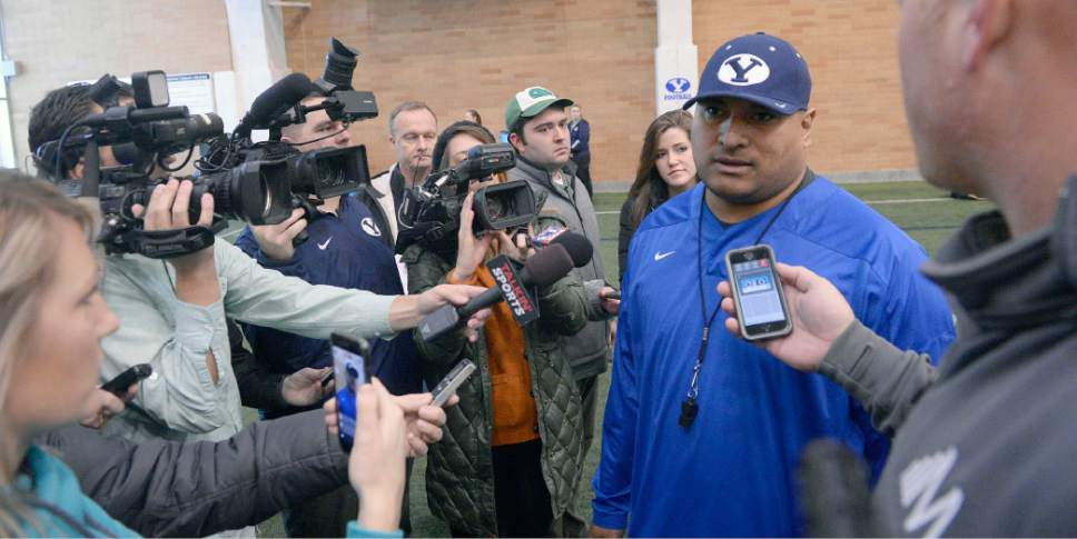 Al Hartmann  |  The Salt Lake Tribune BYU head football coach Kalani Sitake talks to the media after the first practice of BYU's Spring training camp Monday Feb. 27 at the Indoor Practice Facility.