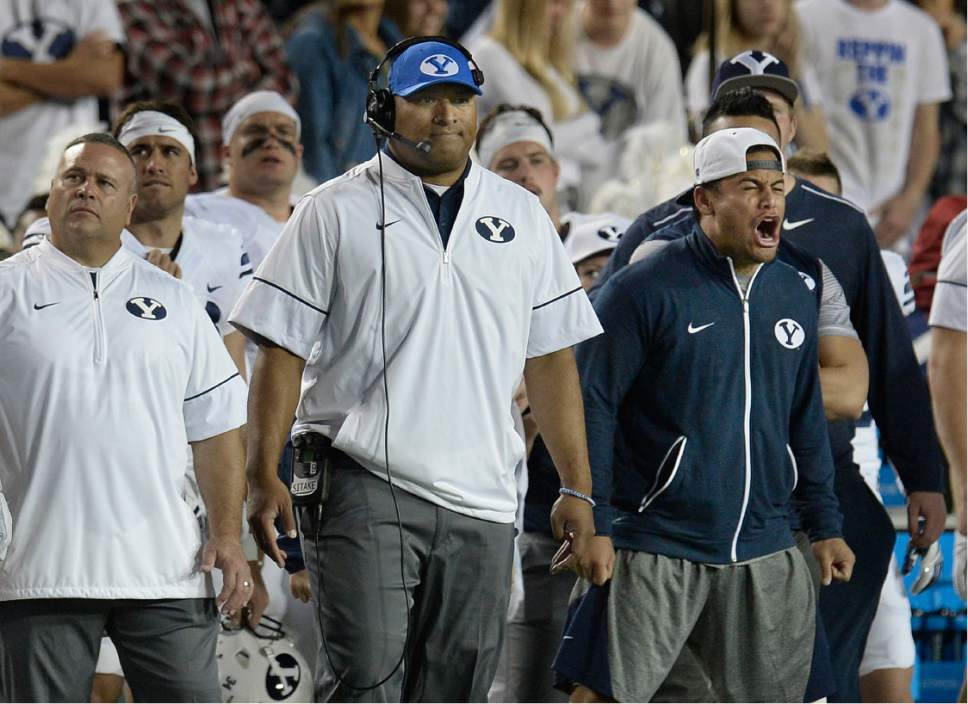Scott Sommerdorf   |  The Salt Lake Tribune   BYU head coach Kalani Sitake and the BYU bench wait for Toldeo to attempt a field goal late in the first half. The kicked was blocked. BYU and Toledo were tied 21-21 at the half, Friday, September 30, 2016.