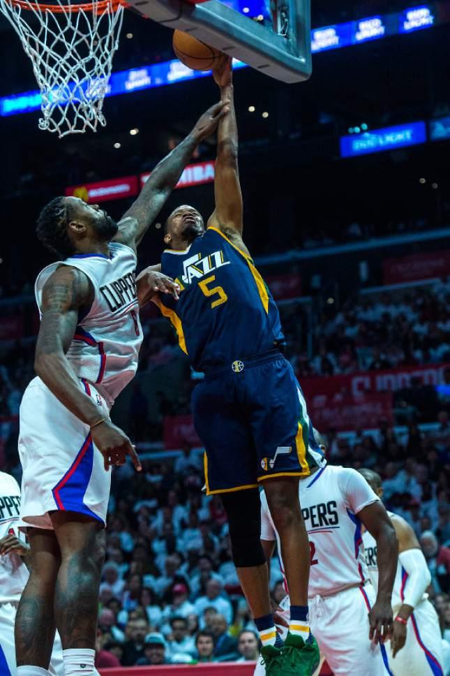 Chris Detrick  |  The Salt Lake Tribune Utah Jazz guard Rodney Hood (5) shoots past LA Clippers center DeAndre Jordan (6) during Game 1 of the Western Conference at the Staples Center Saturday, April 15, 2017.  Utah Jazz defeated LA Clippers 97-95.