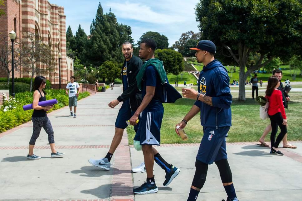 Chris Detrick  |  The Salt Lake Tribune Utah Jazz center Rudy Gobert (27) Utah Jazz guard Rodney Hood (5) and Utah Jazz guard George Hill (3) walk around UCLA after a practice at the Student Activities Center Monday, April 17, 2017.