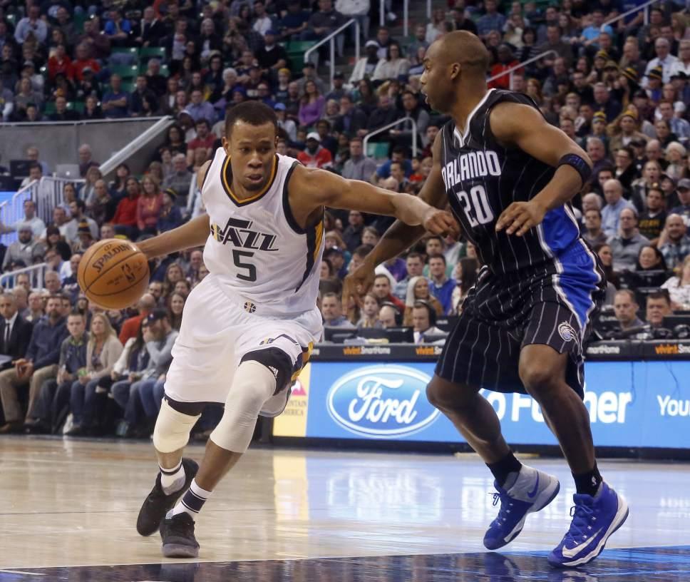Utah Jazz's Rodney Hood (5) dribbles past Orlando Magic's Jodie Meeks (20) during the second half of an NBA basketball game Saturday, Jan. 14, 2017, in Salt Lake City. The Jazz won 114-107. (AP Photo/Kim Raff)