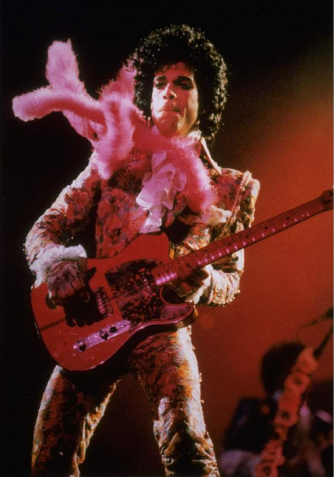 FILE - In this Jan. 11, 1985 file photo, Prince performs before a sold-out audience, in Houston. Prince's publicist has confirmed that Prince died at his his home in Minnesota, Thursday, April 21, 2016. He was 57. (AP Photo/F. Carter Smith, File)