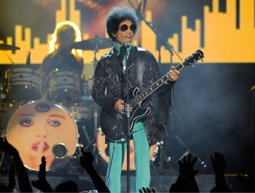 FILE - In this May 19, 2013 file photo, Prince performs at the Billboard Music Awards at the MGM Grand Garden Arena in Las Vegas. Prince was found dead at his home on April 21, 2016, in suburban Minneapolis. He was 57. (Photo by Chris Pizzello/Invision/AP, File)