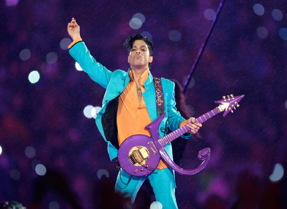 """FILE - In this Feb. 4, 2007 file photo, Prince performs during the halftime show at the Super Bowl XLI football game at Dolphin Stadium in Miami. For the first full sales week following Prince's death on April 21, 2016, five of his albums were in Billboard's top 10, at Nos. 2, 3, 4, 6 and 7. Only Beyonce's """"Lemonade"""" kept him from the top. Billboard says no artist has had that many albums in the Top 10. (AP Photo/Chris O'Meara, File)"""