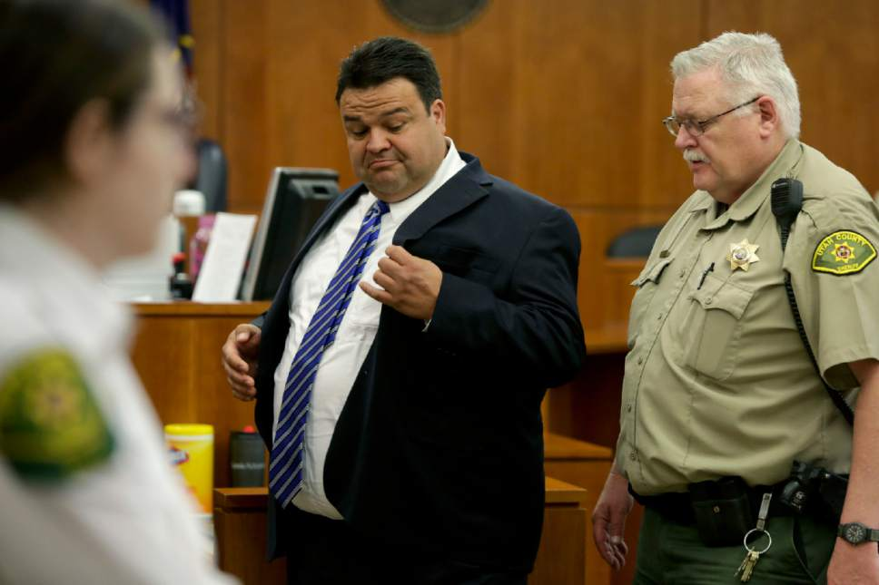 """In this Thursday, March 30, 2017, photo, Keith Vallejo leaves the courtroom, in Provo, Utah. A Utah judge sentencing the former Mormon bishop said the convicted rapist was an """"extraordinary, good man"""" who did something wrong. The Salt Lake Tribune reports that Judge Thomas Low appeared to become emotional on Wednesday, April 12, 2017, when he sentenced Vallejo to up to life in prison for 10 counts of forcible sexual abuse and one count of object rape. (Dominic Valente/Daily Herald via AP, Pool)"""