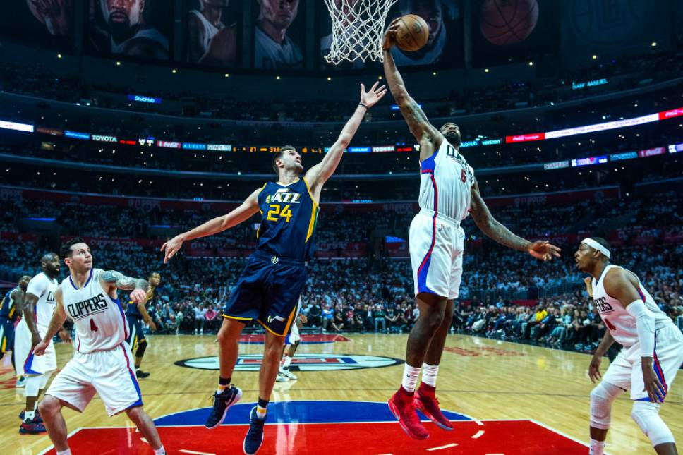 Chris Detrick  |  The Salt Lake Tribune LA Clippers center DeAndre Jordan (6) grabs a rebound past Utah Jazz center Jeff Withey (24) during Game 2 of the Western Conference at the Staples Center Tuesday, April 18, 2017.