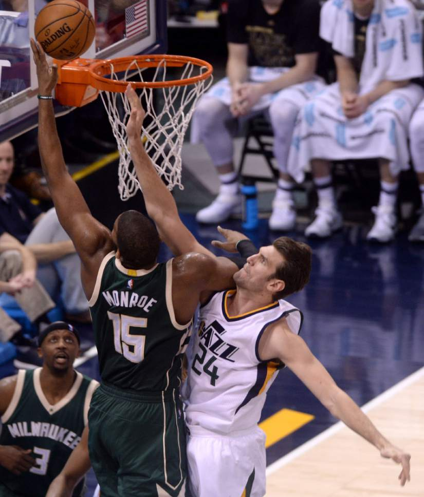 Steve Griffin / The Salt Lake Tribune   Milwaukee Bucks center Greg Monroe (15) gets past Utah Jazz center Jeff Withey (24) for two points during NBA game at Vivint Smart Home Arena in Salt Lake City Wednesday February 1, 2017.