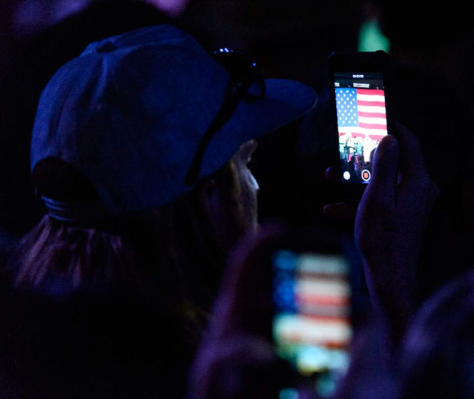 "Steve Griffin  |  The Salt Lake Tribune   People record the speech of Bernie Sanders as he talks during the ""Come Together and Fight Back"" tour at the Rail Center in Salt Lake City Friday April 21, 2017."
