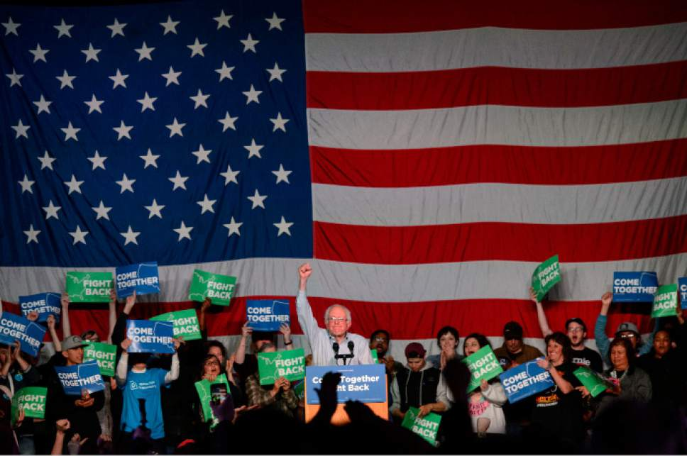 "Steve Griffin  |  The Salt Lake Tribune   Bernie Sanders holds his fist up to the crowd as he concludes his speach during  the ""Come Together and Fight Back"" tour at the Rail Center in Salt Lake City Friday April 21, 2017."