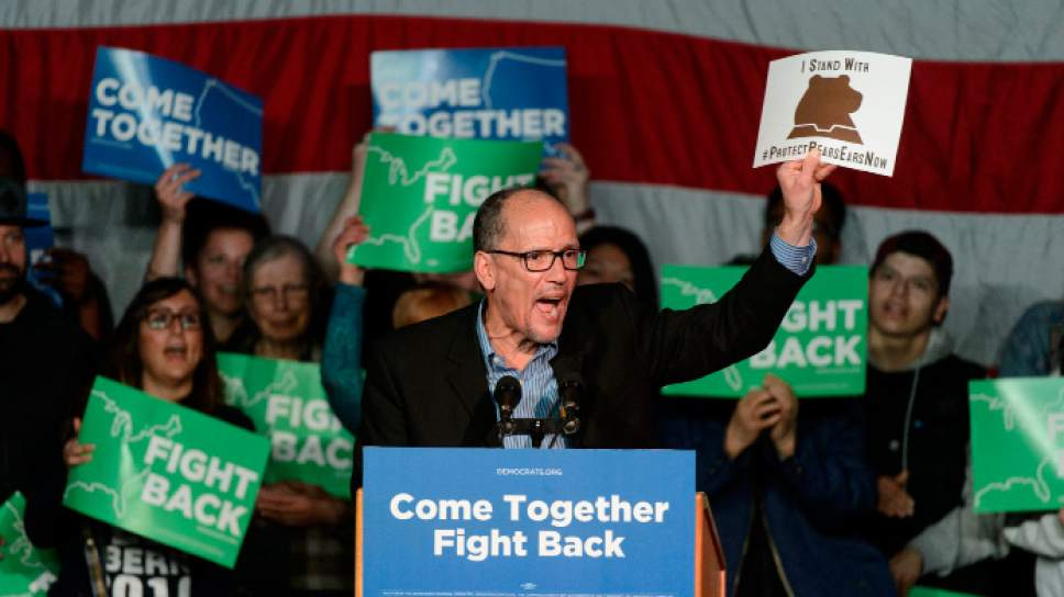 "Steve Griffin  |  The Salt Lake Tribune   Tom Perez, Chair of the Democratic National Committee, holds up a protect Bears Ears sign as he fires up the capacity crowd during the ""Come Together and Fight Back"" tour with Bernie Sanders at the Rail Center in Salt Lake City Friday April 21, 2017."