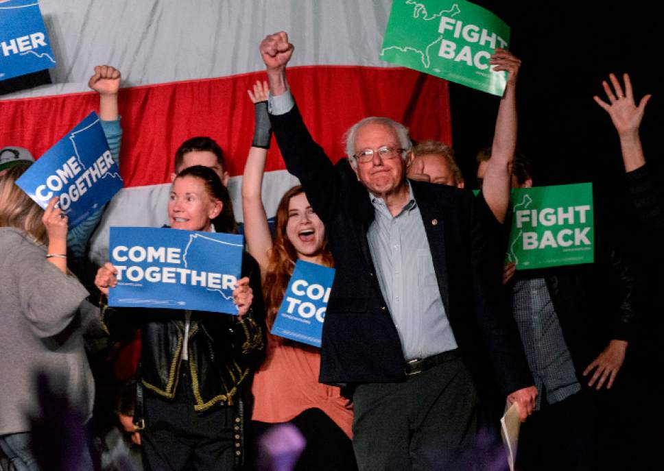 "Steve Griffin  |  The Salt Lake Tribune Bernie Sanders pumps his fist as he takes the stage for the ""Come Together and Fight Back"" tour at the Rail Center in Salt Lake City Friday April 21, 2017."
