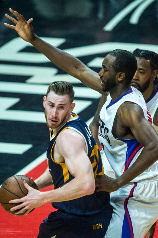 Chris Detrick  |  The Salt Lake Tribune LA Clippers forward Luc Mbah a Moute (12) and LA Clippers center DeAndre Jordan (6) guard Utah Jazz forward Gordon Hayward (20) during Game 2 of the Western Conference at the Staples Center Tuesday, April 18, 2017.