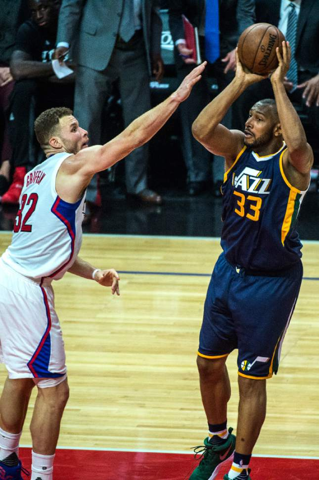 Chris Detrick  |  The Salt Lake Tribune Utah Jazz center Boris Diaw (33) shoots past LA Clippers forward Blake Griffin (32) during Game 2 of the Western Conference at the Staples Center Tuesday, April 18, 2017.