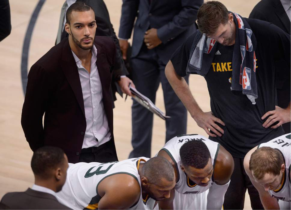 Scott Sommerdorf   The Salt Lake Tribune Injured Utah Jazz center Rudy Gobert (27) sits on the edges of a Jazz time out during first half play. Utah took a 58-49 lead at the half of Game 3 of the Western Conference playoff series, Friday, April 21, 2017.