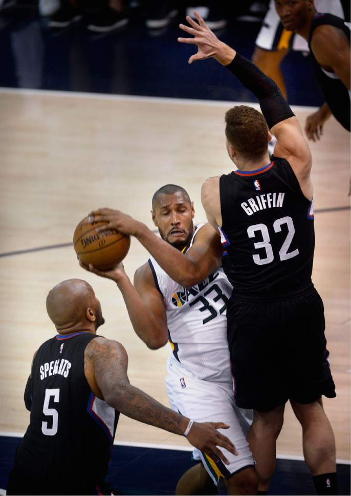 Scott Sommerdorf   The Salt Lake Tribune Utah Jazz center Boris Diaw (33) gets sandwiched between LA Clippers center Marreese Speights (5) and  LA Clippers forward Blake Griffin (32) during first half play. Utah took a 58-49 lead at the half of Game 3 of the Western Conference playoff series, Friday, April 21, 2017.