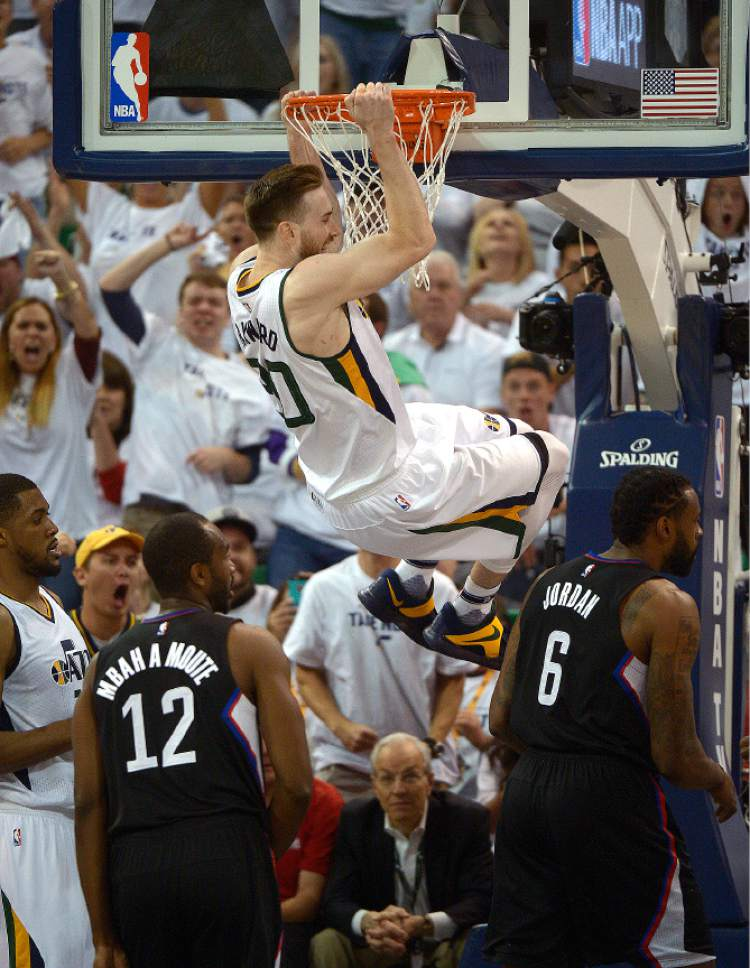 Leah Hogsten     The Salt Lake Tribune  Utah Jazz forward Gordon Hayward (20) stuffs the net over LA Clippers forward Luc Mbah a Moute (12) and LA Clippers center DeAndre Jordan (6). The Utah Jazz lead the Los Angeles Clippers after the third quarter during Game 3 of their first-round Western Conference playoff series at Vivint Smart Home Arena, Friday, April 21, 2017.