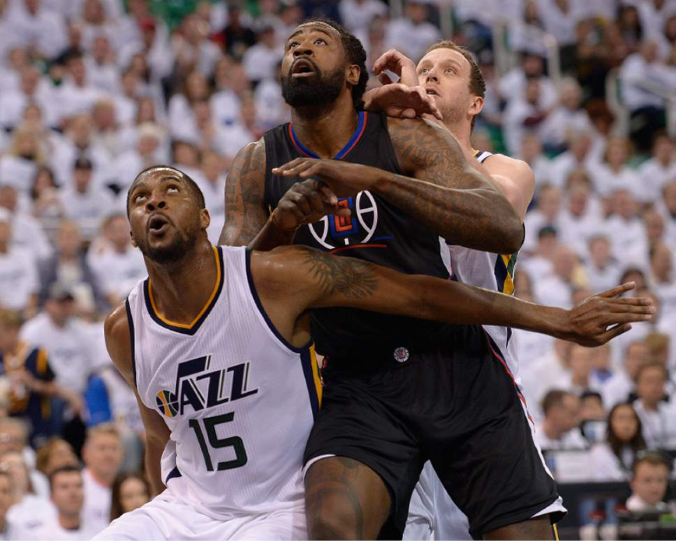 Leah Hogsten     The Salt Lake Tribune  Utah Jazz forward Derrick Favors (15) battles LA Clippers center DeAndre Jordan (6) for the rebound. The Utah Jazz lead the Los Angeles Clippers after the third quarter during Game 3 of their first-round Western Conference playoff series at Vivint Smart Home Arena, Friday, April 21, 2017.