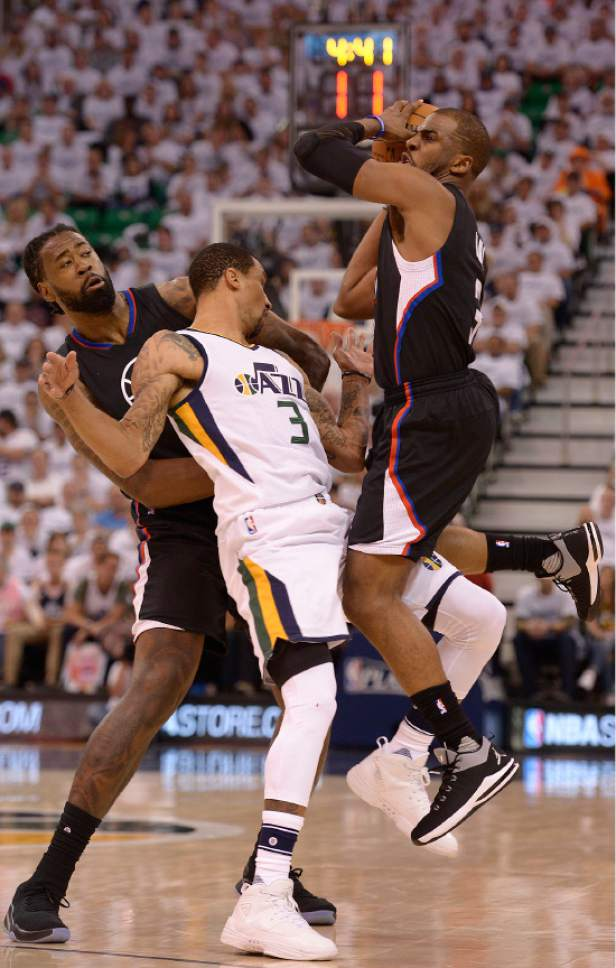 Leah Hogsten     The Salt Lake Tribune  Utah Jazz guard George Hill (3) gets the foul on this play battling LA Clippers center DeAndre Jordan (6) and LA Clippers guard Chris Paul (3). The Utah Jazz lead the Los Angeles Clippers after the third quarter during Game 3 of their first-round Western Conference playoff series at Vivint Smart Home Arena, Friday, April 21, 2017.