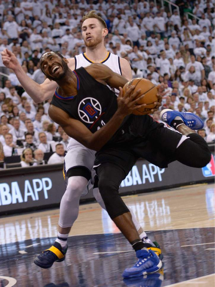 Leah Hogsten     The Salt Lake Tribune  LA Clippers forward Luc Mbah a Moute (12) drives to the net around Utah Jazz forward Gordon Hayward (20) who was given a foul. The Utah Jazz lead the Los Angeles Clippers after the third quarter during Game 3 of their first-round Western Conference playoff series at Vivint Smart Home Arena, Friday, April 21, 2017.