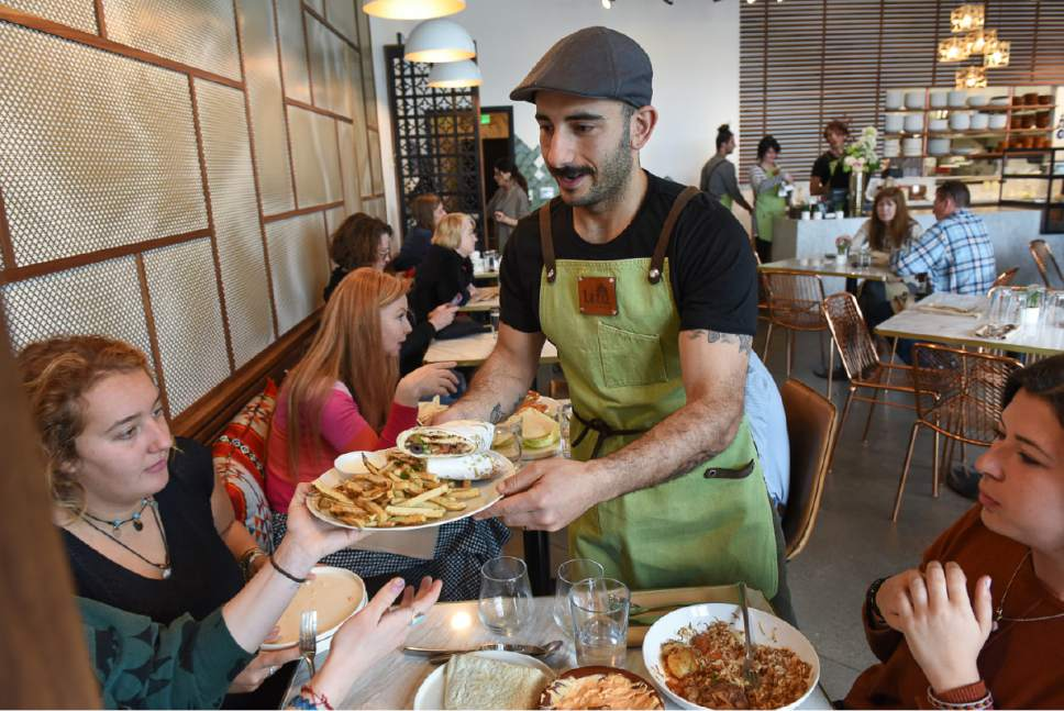 Francisco Kjolseth | The Salt Lake Tribune Moudi Sbeity, chef and owner of Laziz Kitchen, serves up Middle Eastern fare during a recent lunch rush at his new restaurant, in Salt Lake City's Central Ninth District.