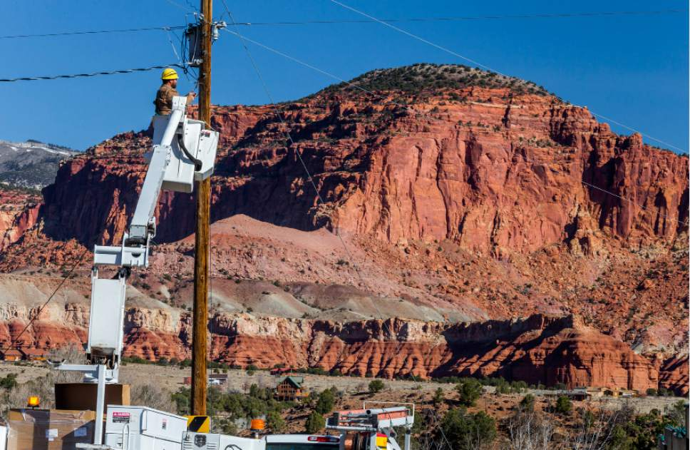 (Scott T. Smith  |  Courtesy)  Garkane Energy lineman Courney Cropper checks a newly installed dark-sky friendly LED streetlight in Torrey. The southern Utah town, the gateway to Capitol Reef National Park, is slated to become the state's first Dark Sky Community.