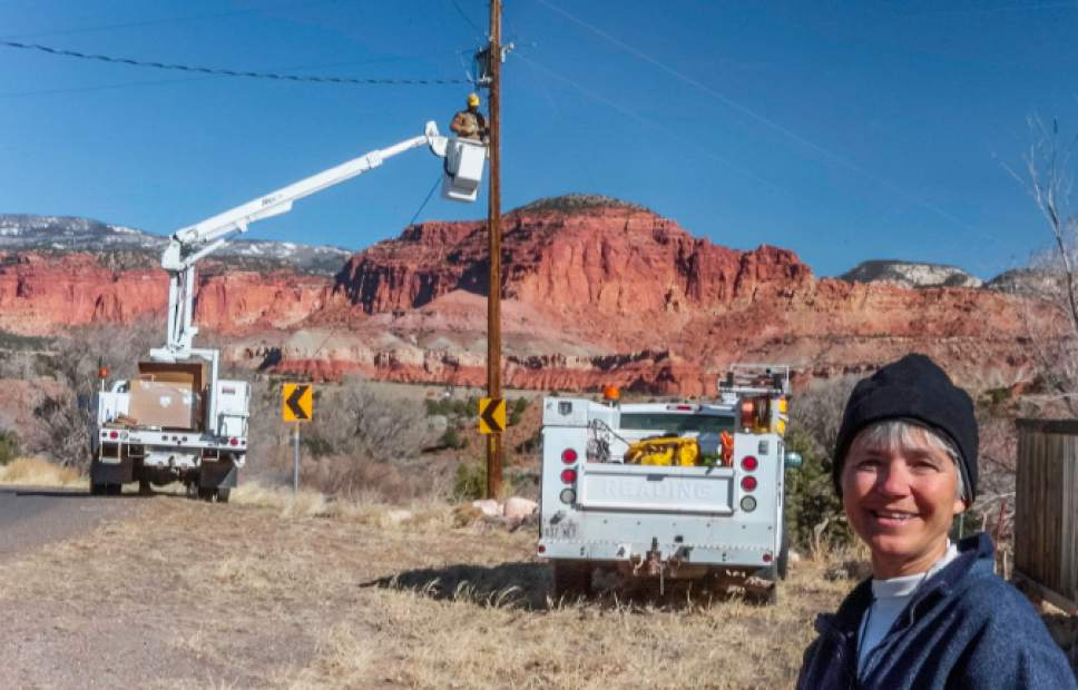 (Scott T. Smith  |  Courtesy)  Mary Bedingfieldsmith watches replacement of Torrey streetlights with dark-sky friendly lights at the end of March.