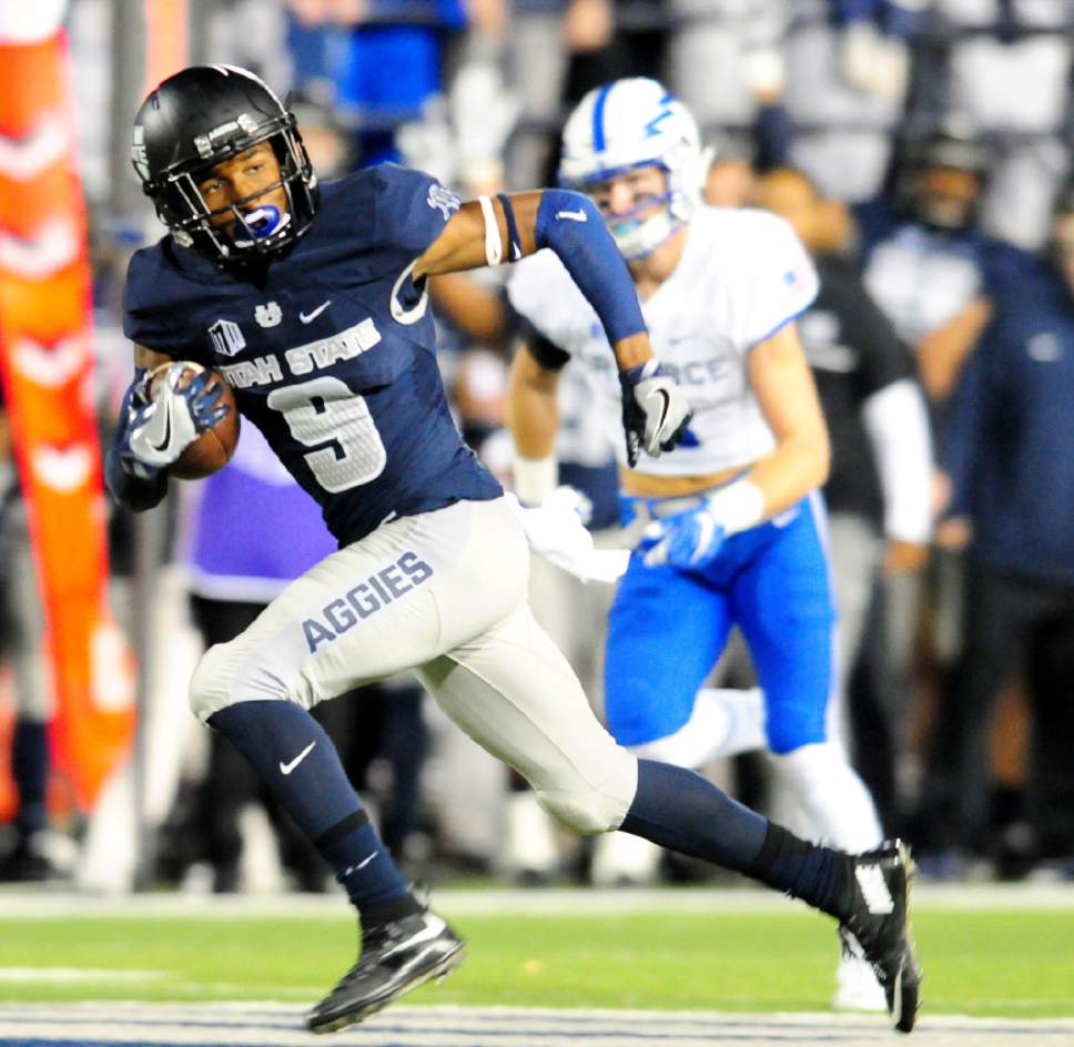 Utah State's Rayshad Lewis runs the ball during an NCAA college football game against Air Force, Saturday, Sept. 24, 2016, in Logan, Utah. (John Zsiray/Herald Journal via AP)