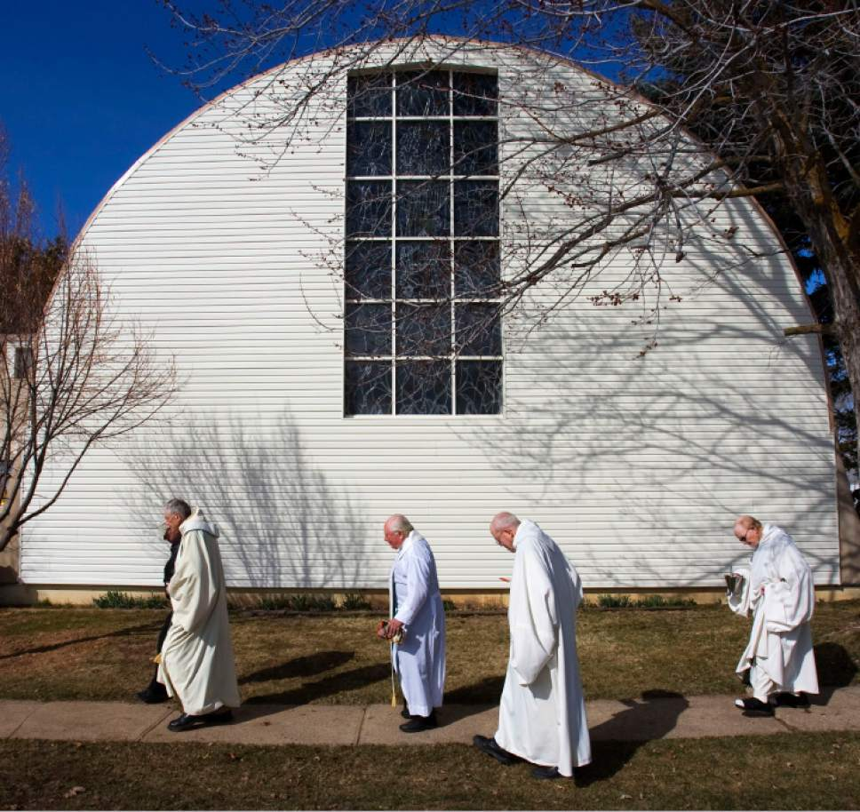 Steve Griffin  |  The Salt Lake Tribune  Huntsville - Monks walk back to the monastery at the Abbey of Our Lady of the Holy Trinity in Huntsville following funeral services for 93-year-old Richard McHale, who took the name Brother Felix, Tuesday Mar 16, 2010.  Brother Felix who came to Huntsville in 1947, was one of the founding members of the monastery. His body was returned to the monastery where we was buried in the cemetery following his funeral. Felix passed away in Christus St. Joseph Villa senior care center in Salt Lake CIty.