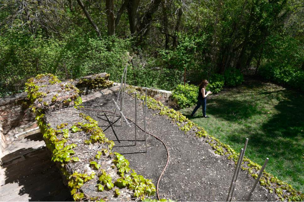 Leah Hogsten     The Salt Lake Tribune  The B.B. Grey House, built in 1912, at 1430 E. Yale Ave., is one of seven in the Yalecrest neighborhood that will be featured Saturday, April 22, during Preservation Utah's 46th Annual Historic Home Tour. Here, owner Christine Martindale walks the terraced backyard, built from materials salvaged from the demolition of houses along South Temple Street during the Great Depression.