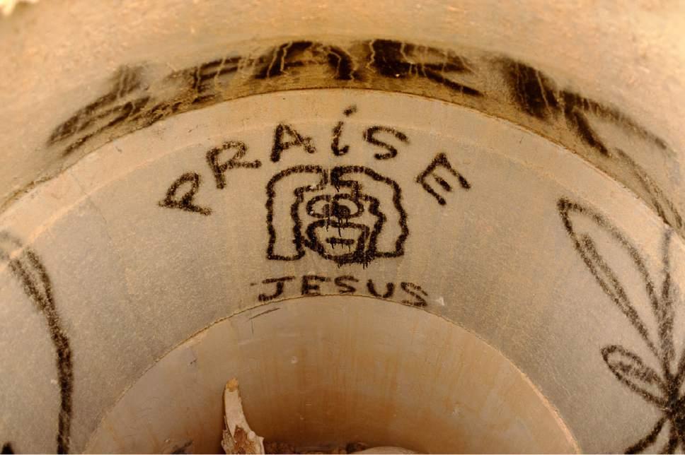Trent Nelson | The Salt Lake Tribune Praise Jesus, graffiti in a drainage pipe, along the trail near Hurricane, Sunday, Feb. 12, 2017.