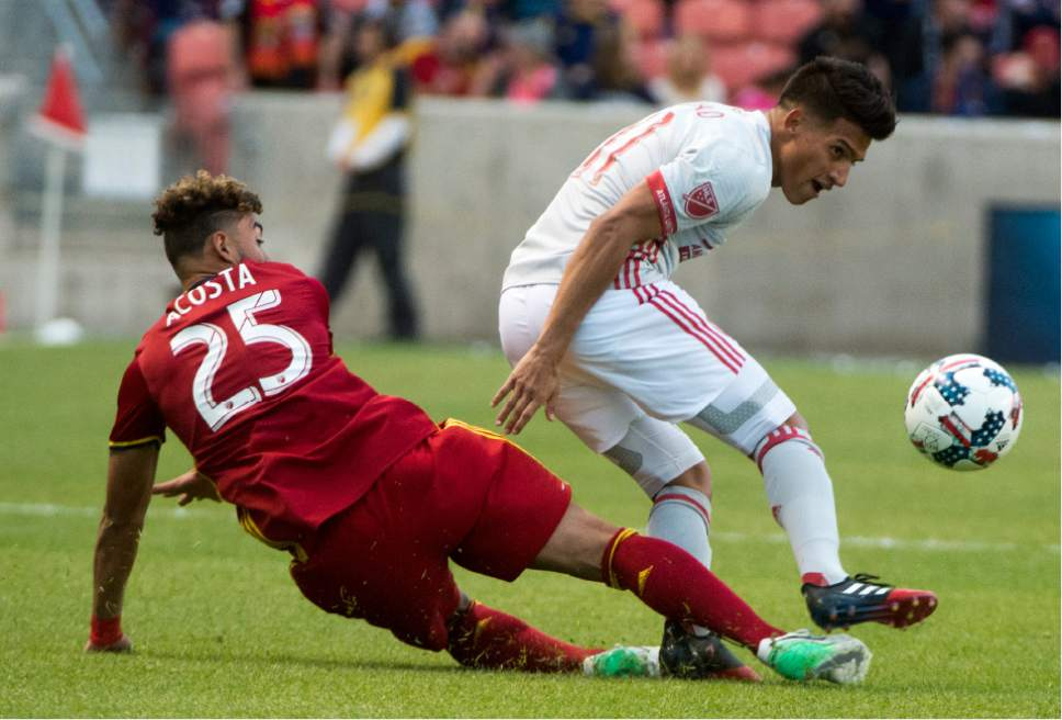 Rick Egan  |  The Salt Lake Tribune  Real Salt Lake midfielder Danilo Acosta (25) kicks the ball past Atlanta United midfielder Yamil Asad (11), in Real Salt Lake Vs. Atlanta United, at Rio Tinto Stadium, Wednesday, April 22, 2017.