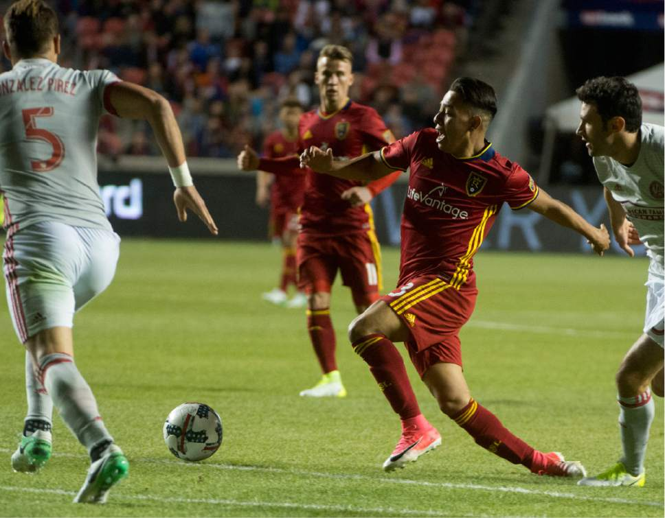 Rick Egan  |  The Salt Lake Tribune  Real Salt Lake midfielder Sebastian Saucedo (23) gets tripped, as heroes for the ball, in Real Salt Lake Vs. Atlanta United, at Rio Tinto Stadium, Wednesday, April 22, 2017.