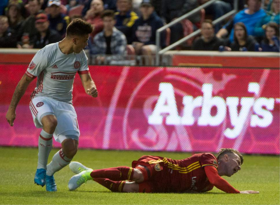 Rick Egan  |  The Salt Lake Tribune  Real Salt Lake midfielder Albert Rusnak (11) gets knocked to the ground by Atlanta United forward Hector Villalba (15), in MLS action, Real Salt Lake Vs. Atlanta United, at Rio Tinto Stadium, Wednesday, April 22, 2017.