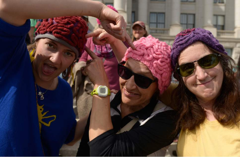 "Leah Hogsten  |  The Salt Lake Tribune  l-r Bianca Winward, her mother Doreen Kulikowski and friend Leslie Sieburth wear the ""brain"" hats made by Kulikowski on Saturday. March for Science Salt Lake City and other leading scientific, academic, and educational institutions and organizations from Utah strolled up State Street to the Utah Capitol to  highlight the benefit of science within society, and to encourage legislators to use evidence-based science in the policy-making process in celebration of Earth Day, April 22, 2017."