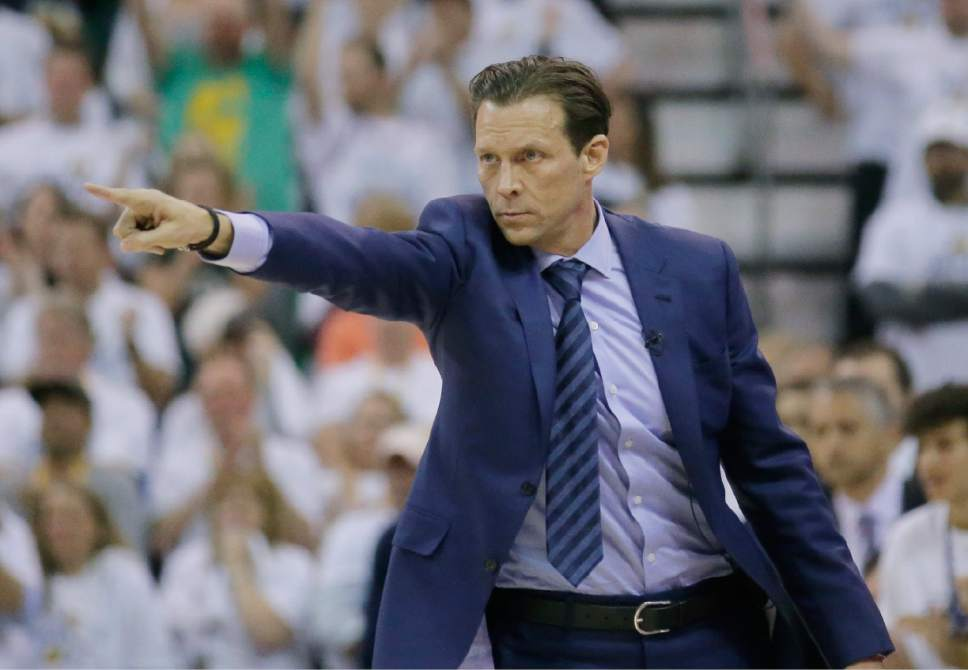 Utah Jazz head coach Quin Snyder points up court during the second half in Game 4 of an NBA basketball first-round playoff series against the Los Angeles Clippers on Sunday, April 23, 2017, in Salt Lake City. The Jazz won 105-98. (AP Photo/Rick Bowmer)