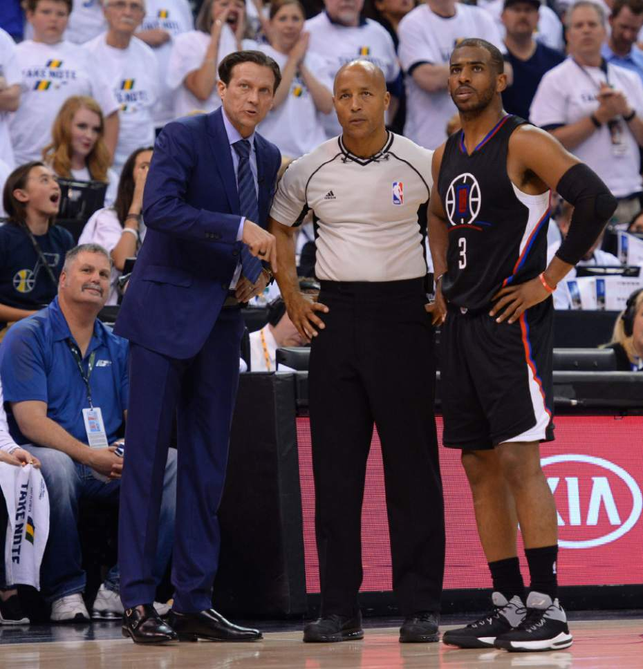 Steve Griffin  |  The Salt Lake Tribune   Utah Jazz head coach Quin Snyder and LA Clippers guard Chris Paul (3) stand with the ref during the Jazz versus Clippers NBA playoff game at Viviint Smart Home arena in Salt Lake City Sunday April 23, 2017.