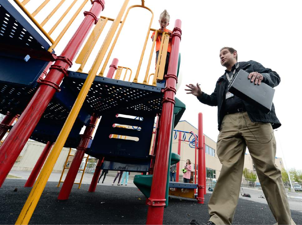 Francisco Kjolseth | The Salt Lake Tribune Zach Torres-George, an environmental health scientist with the Salt Lake County Health Department performs a safety inspection of the playground at Woodrow Wilson Elementary in Salt Lake. Next week is National Playground Safety Week and the health department is looking to promote safe practices on the playgrounds.