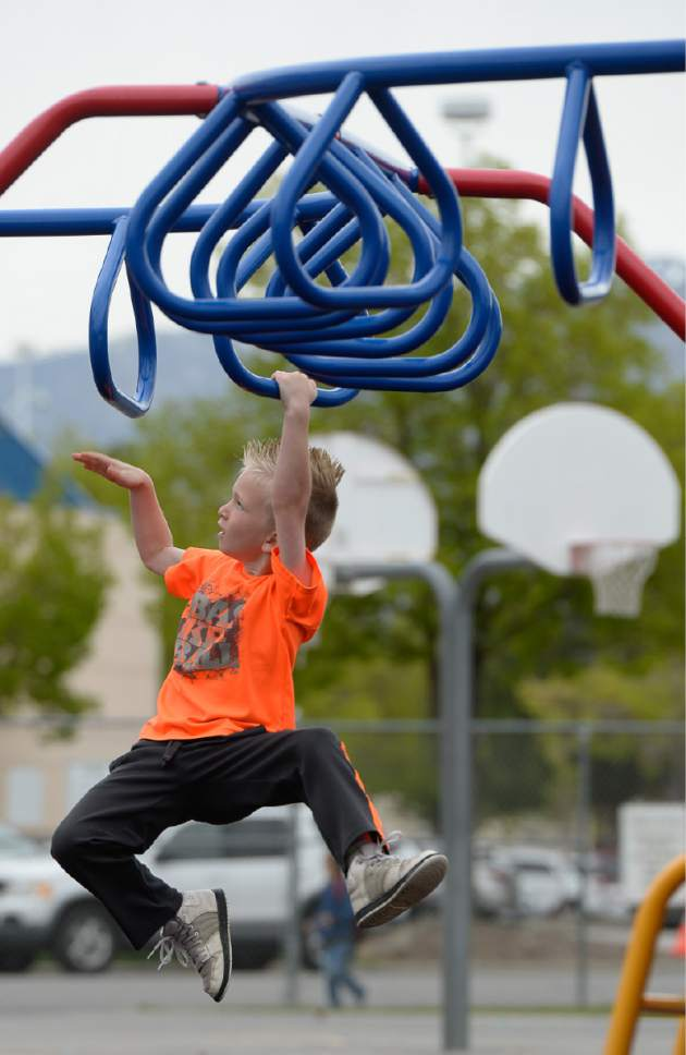 Francisco Kjolseth | The Salt Lake Tribune Cole Johnson, 6, shows off his athletic skills as he visits the playground at Woodrow Wilson Elementary in Salt Lake on Monday, April 24, 2017. Next week is National Playground Safety Week and the health department is looking to promote safe practices on playgrounds as they perform inspections. The health department released a new study showing that 67 percent of Utah elementary student (grades K-6) injuries that take place at school are on the playground. About 1700 elementary school students were injured each year from 2012 to 2015, enough to fill 24 school busses.
