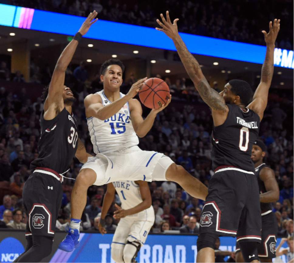 Duke's Frank Jackson (15) looks to pass as South Carolina's Sindarius Thornwell (0) and Chris Silva (30) defend during the first half in a second-round game of the NCAA men's college basketball tournament in Greenville, S.C., Sunday, March 19, 2017. (AP Photo/Rainier Ehrhardt)