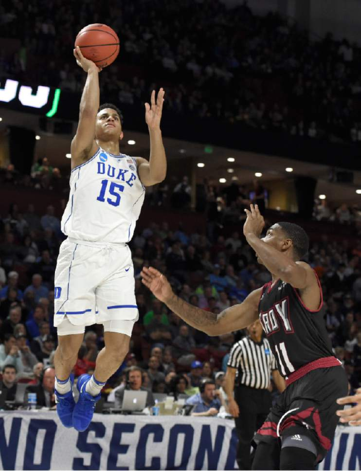 Duke's Frank Jackson (15) shoots over Troy's B.J. Miller (11) during the first half in a first-round game of the NCAA men's college basketball tournament in Greenville, S.C., Friday, March 17, 2017. (AP Photo/Rainier Ehrhardt)