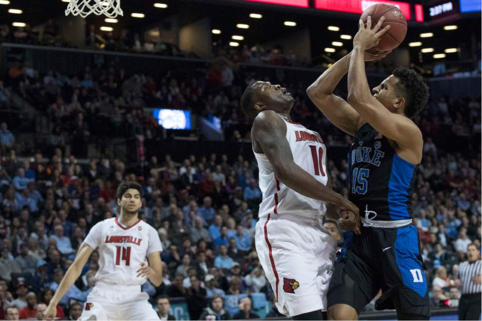 Duke guard Frank Jackson (15) shoots over Louisville forward Jaylen Johnson (10) during the first half of an NCAA college basketball game in the Atlantic Coast Conference tournament, Thursday, March 9, 2017, in New York. (AP Photo/Mary Altaffer)