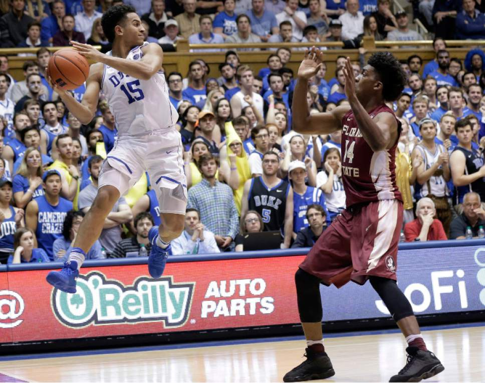 Duke's Frank Jackson (15) looks to pass while Florida State's Terance Mann (14) defends during the second half of an NCAA college basketball game in Durham, N.C., Tuesday, Feb. 28, 2017. Duke won 75-70. (AP Photo/Gerry Broome)