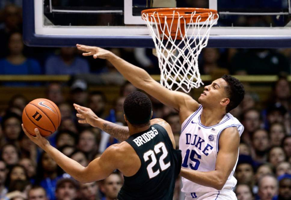 Duke's Frank Jackson (15) defends against Michigan State's Miles Bridges (22) during the first half of an NCAA college basketball game in Durham, N.C., Tuesday, Nov. 29, 2016. (AP Photo/Gerry Broome)