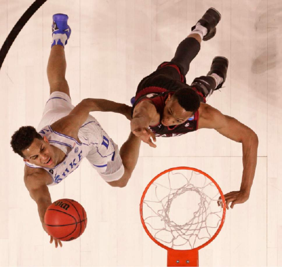 Duke's Frank Jackson, left, drives past Troy's B.J. Miller, right, during the second half in a first-round game of the NCAA men's college basketball tournament in Greenville, S.C., Friday, March 17, 2017. (AP Photo/Rainier Ehrhardt)