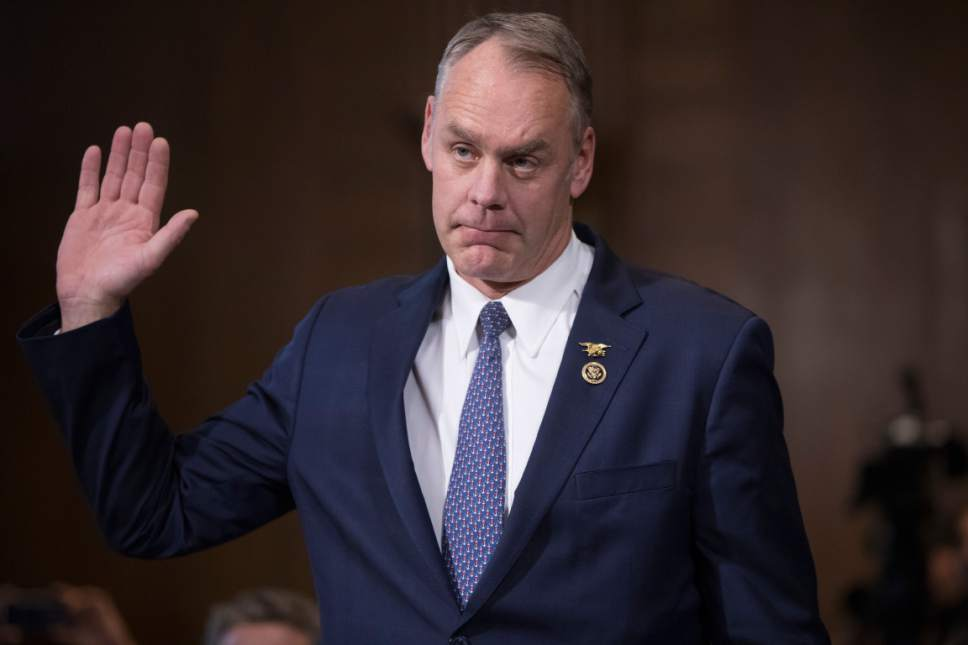 Interior Secretary-designate, Rep. Ryan Zinke, R-Mont., is sworn in on Capitol Hill in Washington, Tuesday, Jan. 17, 2017, prior to testifying at his confirmation hearing before the Senate Energy and Natural Resources Committee. Zinke, 55, a former Navy SEAL now in his second term in Congress, was an early supporter of President-elect Donald Trump and, like his prospective boss, has expressed skepticism about the urgency of climate change. (AP Photo/J. Scott Applewhite)