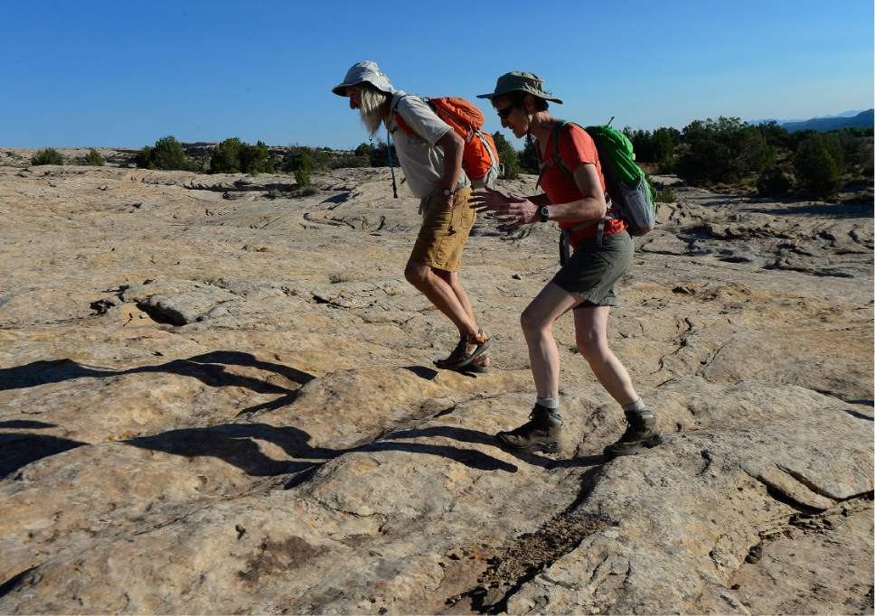 Scott Sommerdorf   |  The Salt Lake Tribune   U.S. Interior Secretary Sally Jewell walks with Vaughn Hadenfeldt of Friends of Cedar Mesa, over the slickrock on the way to Butler Wash to view petroglyphs - some of which have been vandalized -  Saturday, July 16, 2016.