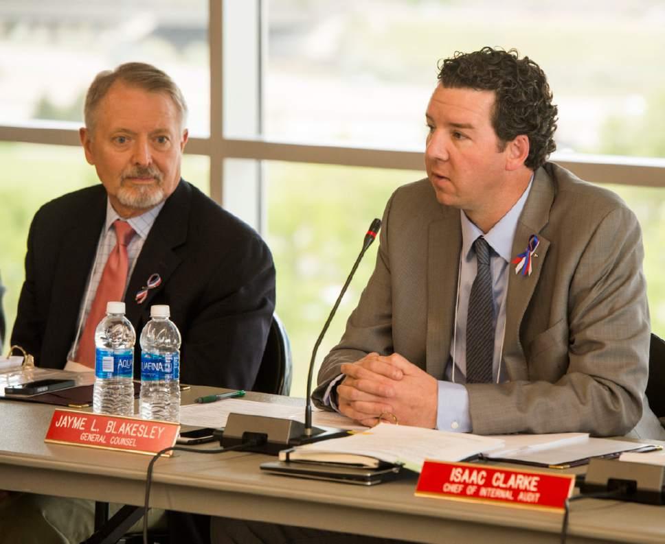 Rick Egan  |  The Salt Lake Tribune  Robert W. McKinley listens as Jayme Blakesley makes a comment at the Utah Transit Authority Board meeting at Utah Valley University, Wednesday, May 25, 2016.
