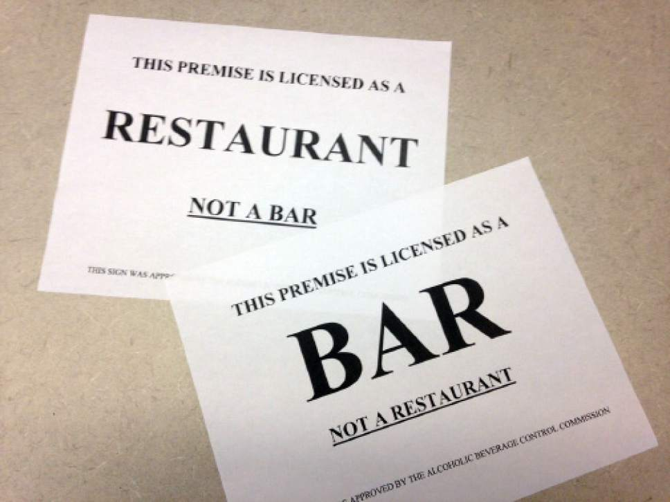 New signs like these are designed to help diners in Utah differentiate between bars and restaurants that serve alcohol.
