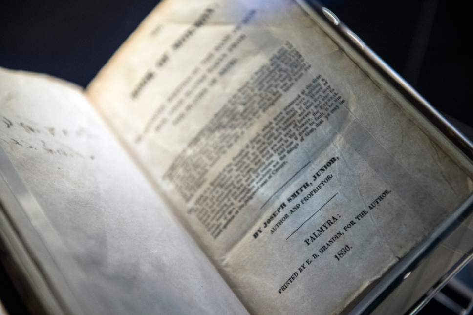 "Tribune file photo The Book of Mormon first edition, 1830, on display at the LDS Church History Library in 2014. LDS and non-LDS scientists are saying that the ""Universal Model"" explanation for Earth's creation, put forward by Dean Sessions, are untested and wouldn't pass peer review."