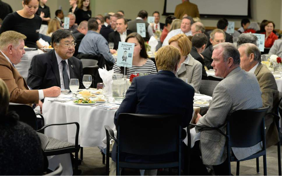 Francisco Kjolseth  |  The Salt Lake Tribune Salt Lake County Councilman Randy Horiuchi, second from left, is joined by friends and developers Kem Gardner, left, and Terry Diehl, second from right, during an event to honor Horiuchi who is retiring.